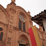 more of the iglesia, and the flag of Cuenca