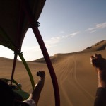 All of us tourists with our camera-arms out of the dune-buggy