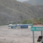 We drove past a crazy flash flood -- these trucks were half buried in mud less than 14 hours before we saw them.